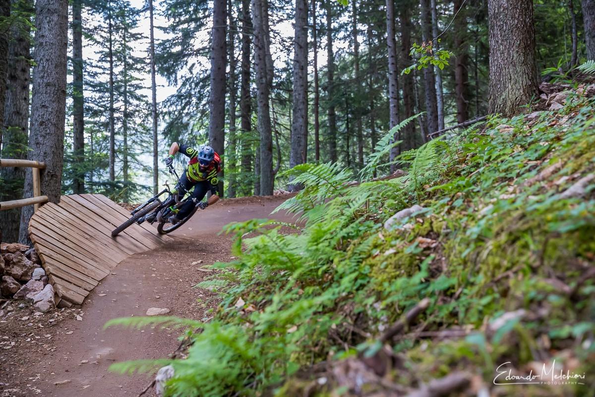 A MTB rider approaching a corner in the Dolomiti Paganella Bike Park