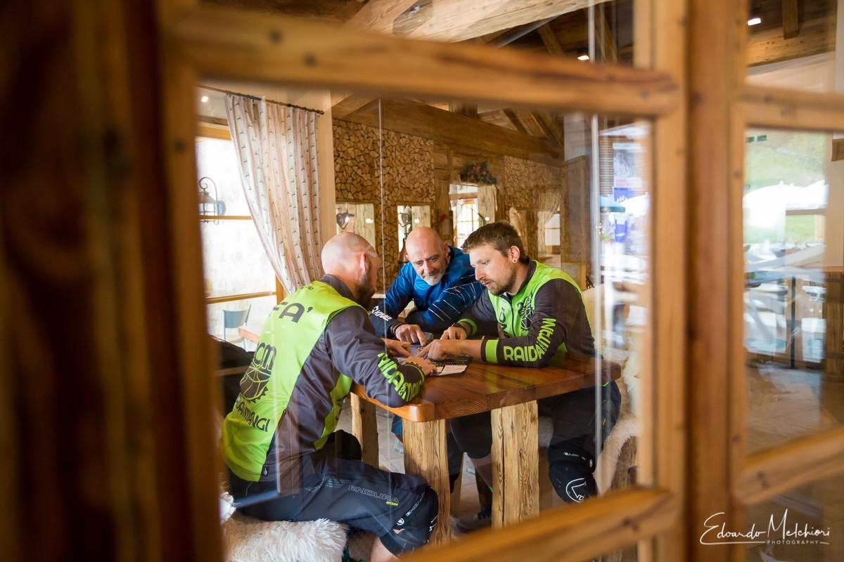 MTB riders get a break in a mountain hut in Dolomiti Paganella